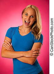 fit young woman in blue t shirt over pink background