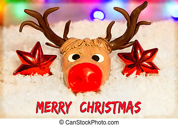 Merry Christmas with a reindeer head made of fondant in the...