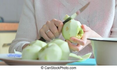 A woman peeled an apple on a plate. Part 2. Woman clears the...