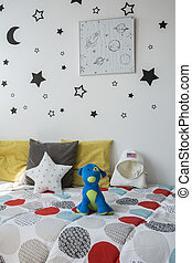 Simple cosmic wall decor idea - Light child bedroom with...