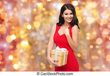 beautiful sexy woman in red dress with gift box