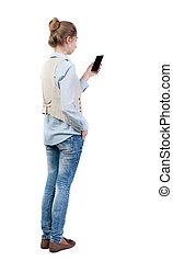 back view of standing young beautiful woman in vest and...