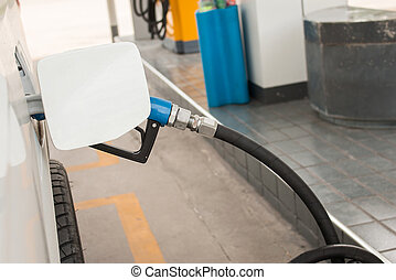 filling Oil Gas Fuel at station