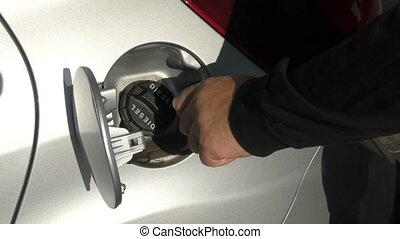 gasoline - man unscrews the cap of the diesel machine
