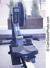Gym exercise rowing machine static rower in fitness studio.