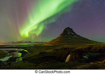 Northern light over Kirkjufell volcano with fully stars on...