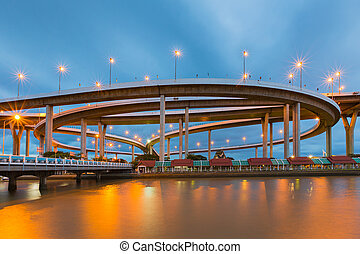 Highway interchange night view - Twilight sky river front...
