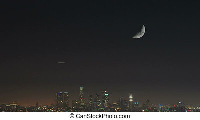 Downtown LA at night tilt with moon