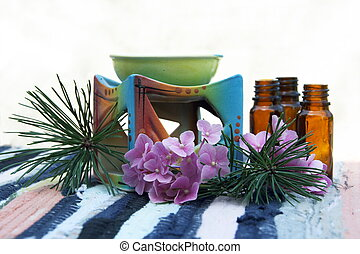 Aroma Oil in Bottles and Candle Bowl