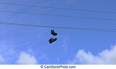 Old boots hanging on an electric wire