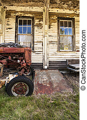 Old tractor on a farm - Old tractor on an old farm in Maine,...