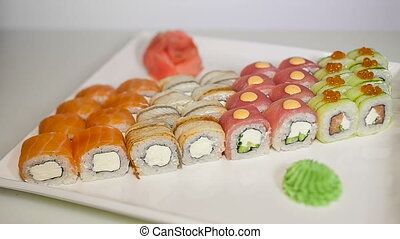 sushi rolls set on the wooden plate