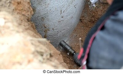 Drilling a hole in concrete well with core drill bit and...