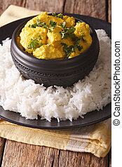 Indian chicken Korma with basmati rice close-up. vertical -...