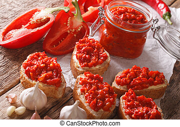 Sandwiches with butter and ajvar close-up. horizontal -...
