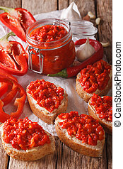 Relish (Ajvar) of Roasted Red Bell Peppers on toast slices...