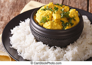 Indian chicken Korma with basmati rice close-up. horizontal...