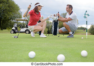 conversation in the golf course