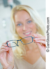 Woman holding some new glasses