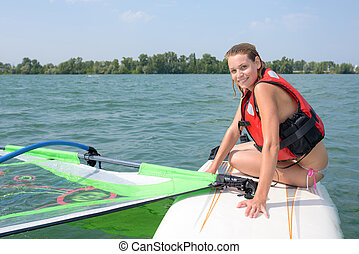 girl doing windsurfing