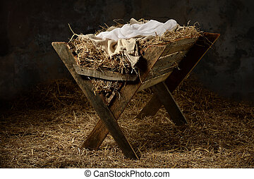 Manger in Stable - Manger with hay and swaddling clothes in...