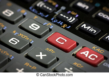 Scientific calculator clear and reset buttons close up with...