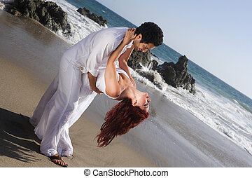 Young Couple at the beach dancing