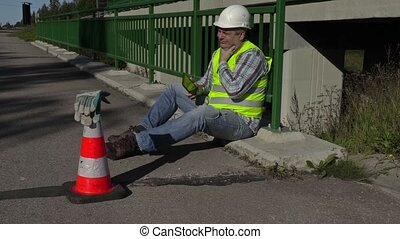 Road construction worker with neck pain
