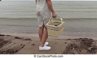 Woman with basket on the beach