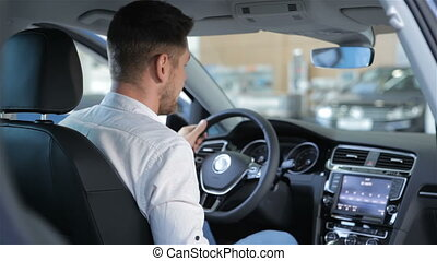 Man touches the touchscreen of car console - Caucasian man...