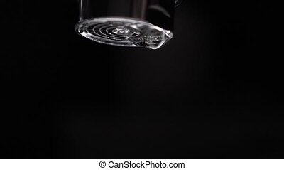 Dripping water tap. Leakage concept. Super slow motion macro...