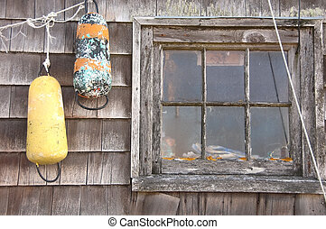 Two lobster Buoys hanging on wall