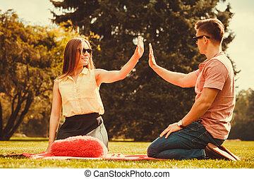 Cheerful couple having fun in park. - Love romance...