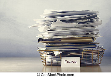 Filing Tray Piled High with Documents in Drab Hues - A...