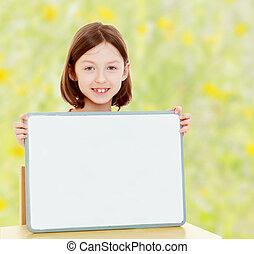Little girl holding white poster - Cute little girl sitting...
