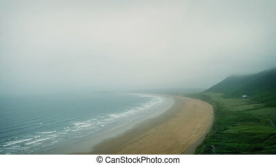 Coastal Landscape On Misty Day - Dramatic misty sea shore...