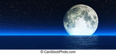 Rising moon over sea. - Blue moon with stars and haze...