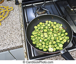sliced courgette in a fryning pan