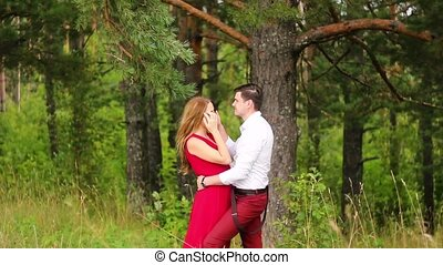 Man and woman walking together in the woods. - Start a...