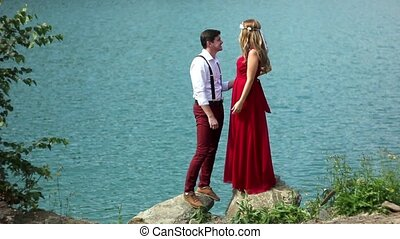 couple holding hands at lake - beautiful young couple...