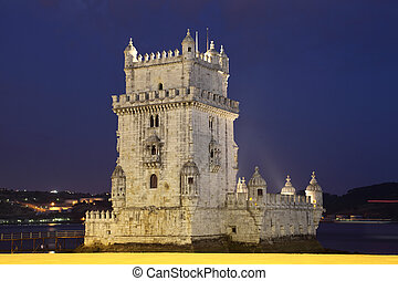 The famous Belem tower illuminated at night, Lisbon Portugal