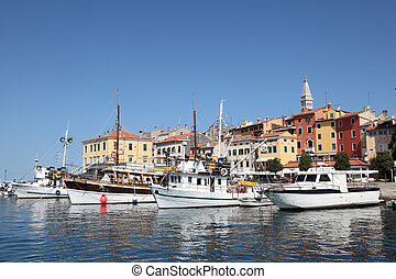 Fishing boats in the old harbor of Rovinj, Croatia
