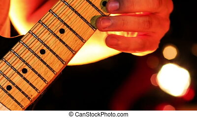 Guitarist Plays Electric Guitar in Night Club - closeup guy...