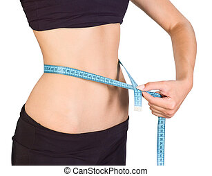 slim waist - Woman is showing how much weight she lost