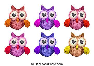 Cartoon clay owls - A set of colorful cartoon clay owls.