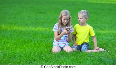 children with smart phone ooutside