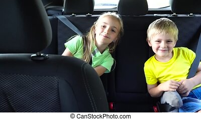 cute kids going in car - two cute kids going in car