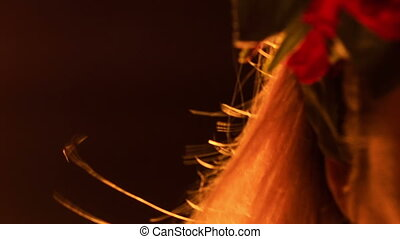 Closeup Wind Shakes Blond Hair on Girl Forehead with Garland...