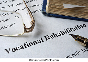 Vocational Rehabilitation written on a paper and a book