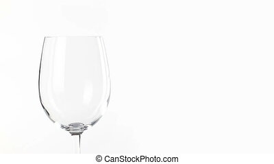 White wine poured into glass